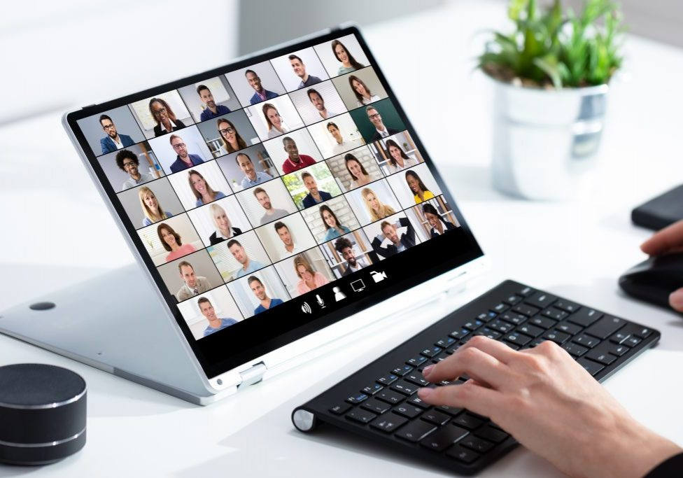 Close-up of businesswoman's hand checking house on laptop